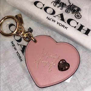 Coach pink heart embellished key fob Selena Gomez